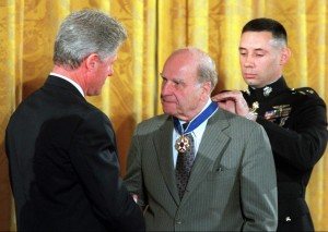 In 1995, United States President Bill Clinton awards the Presidential Medal of Freedom to former US Senator Gaylord Nelson for founding Earth Day.