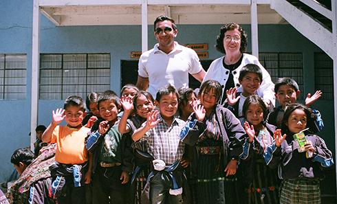 Jayme Illien Chairman, President, and CEO of Illien Global and Executive Director of Illien Adoptions International, Ms Anna Belle Illien with children in Gautemala.